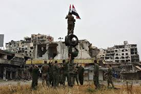 Rebel Syrian Flag Syria Assad U0027s Forces Raise Their Flag Among The Ruins As Rebels