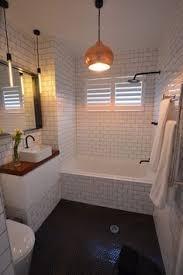Hexagon Tile Bathroom Floor by Bathroom With Herringbone Pattern White Subway Tile Surround And