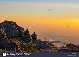 Sunrise Sunset Table Two People Watching The Sunset On Table Mountain Stock Photo