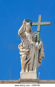 jesus holding cross statue statue of jesus holding a cross above