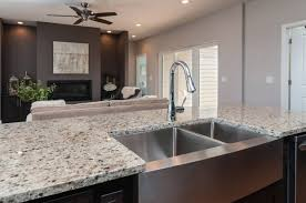kitchen island with stainless farmhouse sink and crema pearl