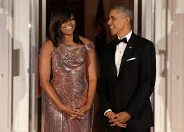 obama dresses obama in a versace gown obama s best