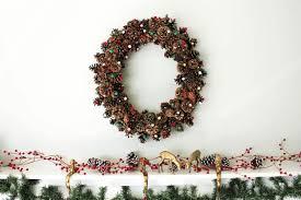 17 creative diy christmas wall decor ideas 10 pine cone wreath with pom poms