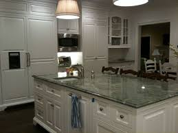 white kitchen cabinets with green countertops granite green granite countertops green countertops