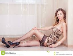 cute woman lying on the floor stockings and leopard dress royalty