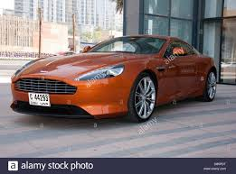orange aston martin copper aston martin virage luxury sports car stock photo royalty