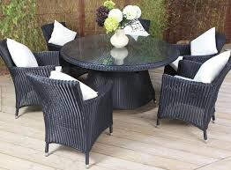 Great Looking Outdoor Dining Room With Square White Cushion And - Round dining table with wicker chairs
