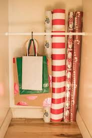 how to store wrapping paper and gift bags 10 ways to organize your wrapping paper and gift bags organizing