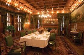 victorian style dining room with green chairs and curtains and