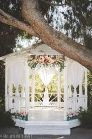 how to decorate a gazebo with fabric an outdoor wedding decoration