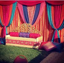 indian wedding decoration rentals wedding ideas inspiration yellow curtains pink cushions and