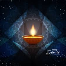 three candles for diwali on a blue background with ornaments