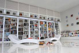 modern library decor with white stained wooden bookcase with white