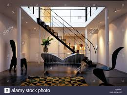 modern apartment interior with metal staircase mezzanine and