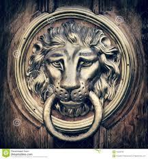 lion door knocker door knocker handle lion vintage stylized stock photo