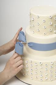 wedding cake tutorial how to put a bow into the side of a cake and tutorial for how to