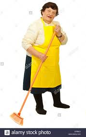 full length of elderly woman with yellow apron cleaning house with