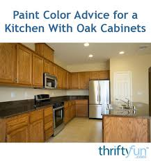 what flooring looks with honey oak cabinets paint color advice for a kitchen with oak cabinets thriftyfun