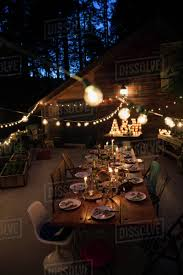 Restaurant String Lights by String Lights Illuminating Food On Dining Table At Night Stock