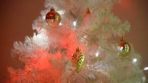 bright illuminations on tree white decorated fir tree