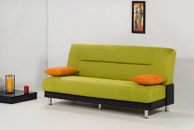 rectangular green sofa bed with back and orange cushions with