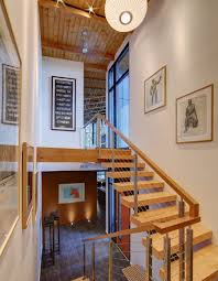 wooden floating staircase with balustrade of horizontal cable