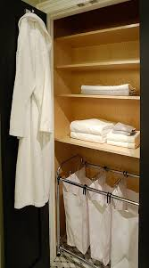 small bathroom closet with laundry sorters transitional bathroom