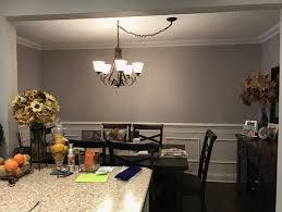 dining room light fixture center do you center the picture on the wall or on the dining room table