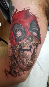 zombie deadpool tattoo on bicep