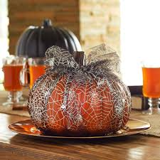 wrap spider web tulle around a craft pumpkin for quick and easy no