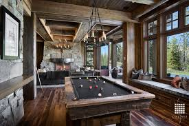 rustic game room with window seat cabot rectangular chandelier