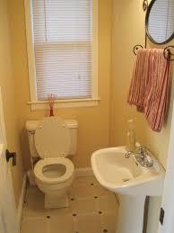 white bathroom sink stand added by white latrine on cream tile