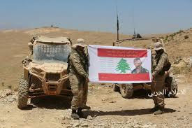Hezbollah Flag Hezbollah Fighters Salute La Martyr Colonel Dani Harb U2013 Al Manar