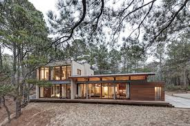 forest house contemporary forest house with curved metal roof
