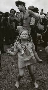 a young hippie dancing at a festival in new orleans