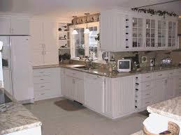 stone countertops white beadboard kitchen cabinets lighting