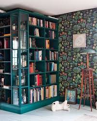 bookcases in every color of the rainbow apartment therapy