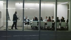 Contemporary Boardroom Tables Businessman Makes Presentation To Group Of Colleagues Seated At