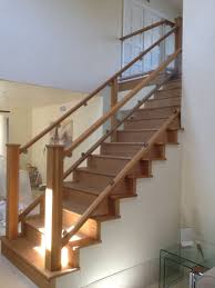 modern stairs designs with wooden treads and glass railing excerpt