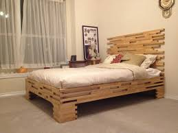 natural pine wood homemade bed frame with stack accent placed on