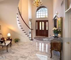 grand foyer staircase chandelier marble floor showcase home