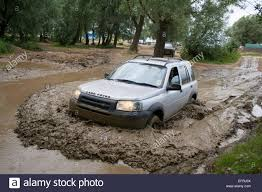 land rover freelander off road land rover freelander driving through water and mud stock photo