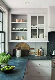 White Kitchen Cabinets And Black Countertops by Rafe Churchill Traditional Houses Little Farmhouse Renovation