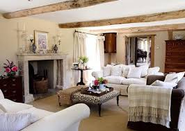white cushions on white fabric sofa and rectangle black spot