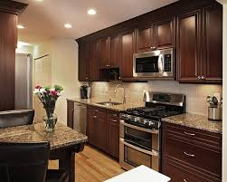 brown kitchen cabinets with backsplash how to pair countertop colors with cabinets