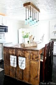 Matching Chandelier And Island Light Crush Of The Week Think Pink Features Farmhouse Kitchen