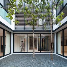 houses with courtyards clever use of louvers and a neutral color scheme transform the
