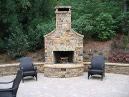 Outdoor Fieldstone Fireplace - outdoor fireplaces ideas with circle seating walls creative