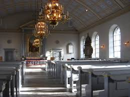 different shades of gray interior of church in norway painted in different shades of grey