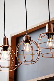 kupferlampen mit metallkorb mit schwarzer fassung und schwarzem
